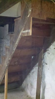 The original stairs; from this angle, you can see the flimsy plywood serving as a ledger.